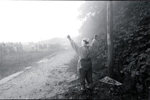"""北井一夫「三里塚」""""Sanrizuka"""" by Kazuo Kitai. Old lady faces the water cannon. 1970s"""
